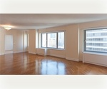 Spacious 4 Bedrooms,4.5 Baths with XXL Private Patio in the Upper East Side - Beautiful Cabinetry and Granite Counter tops, Viking Stove, Large Wine Fridge, Windowed Kitchen, Custom Herringbone Wood Floors, Large Dining Room, Living Room and Den.