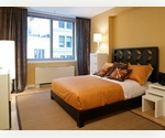 Serene 1 bedroom apartment near Wall Street, South Ferry, South Street Seaport, Fulton Street and East River with oversized windows in a luxury building